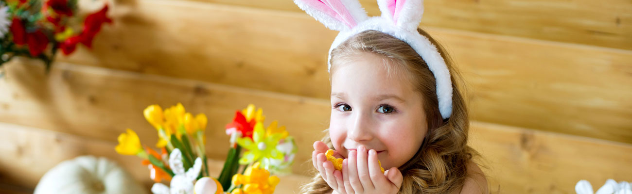 Little girl wearing bunny ears for easter
