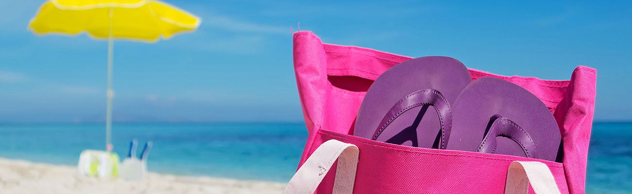 Summertime beach bag on the beach